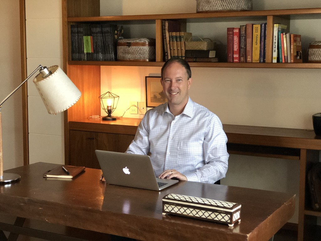 Photo of Andrew at his desk